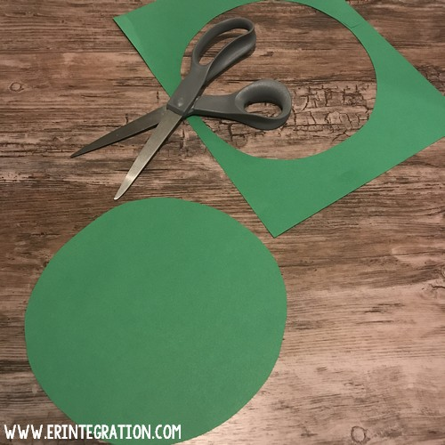 piece of green paper cut into a circle for green screen