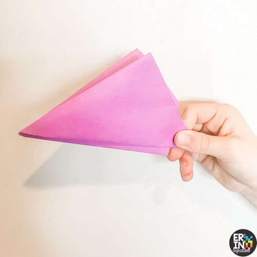 image of pink paper folded into a paper popper